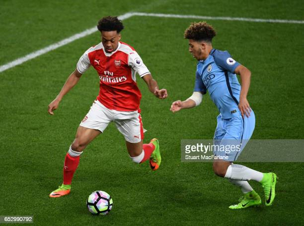 Chris Willock of Arsenal takes on Jadon Sancho of Man City during the Premier League 2 match between Arsenal and Manchester City at Emirates Stadium...