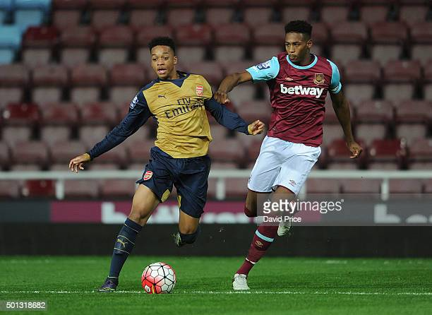 Chris Willock of Arsenal takes on Reece Oxford of West Ham during match between West Ham United U21 and Arsenal U21 at Boleyn Ground on December 14...
