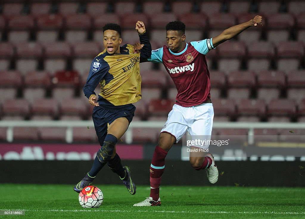 Chris Willock of Arsenal takes on Reece Oxford of West Ham during match between West Ham United U21 and Arsenal U21 at Boleyn Ground on December 14, 2015 in London, England.