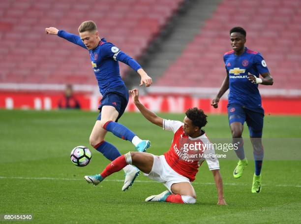 Chris Willock of Arsenal takes on Scott McTominay and Matthew Olosunde of Man United during the Premier League 2 match between Arsenal and Manchester...