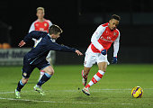 Chris Willock of Arsenal takes on Tom Lowery of Crewe during the match between Arsenal U18 and Crewe Alexandra U18 in the FA Youth Cup 5th Round at...