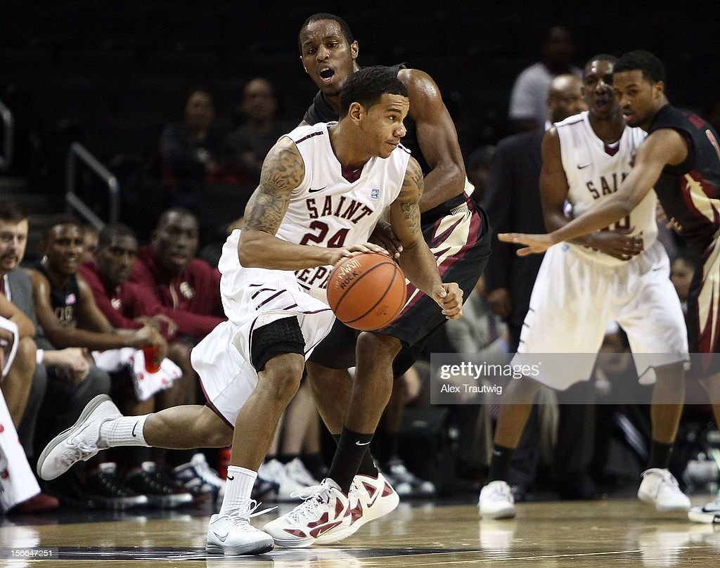 Chris Wilson #24 of the Saint Joseph's Hawks in action against Michael Snaer #21 of the Florida State Seminoles during the championship game of the Coaches Vs. Cancer Classic at the Barclays Center on November 17, 2012 in the Brooklyn borough of New York City.