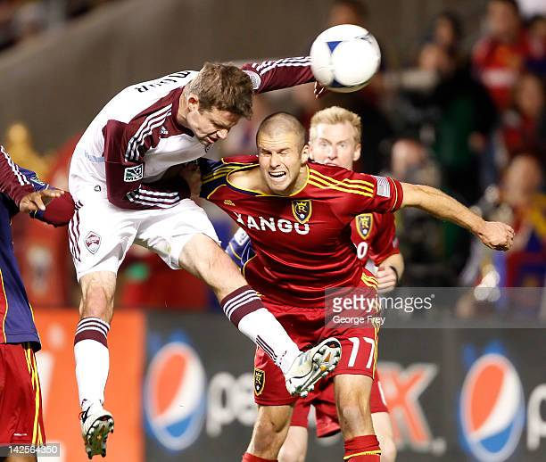 Chris Wingert of Real Salt Lake fights off Drew Moor of Colorado Rapids as Moor heads the ball and takes a shot on goal during the second half of an...