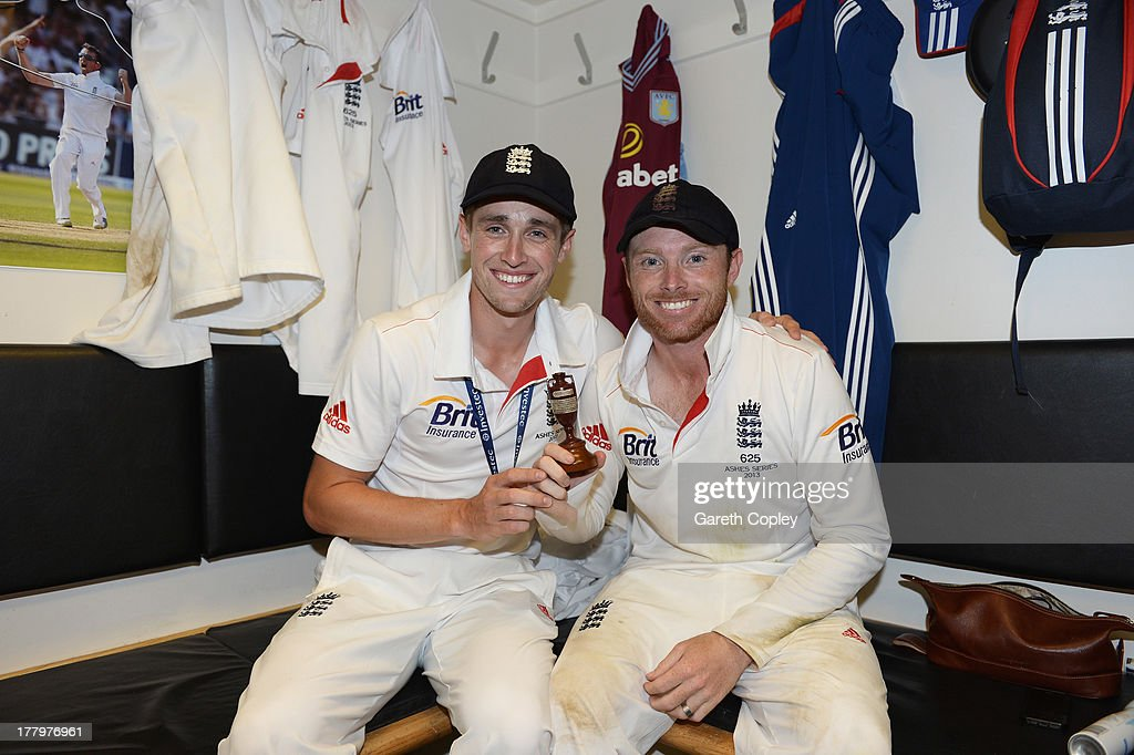 Chris Woakes and Ian Bell of England pose with the urn in the dressing room after winning the Ashes during day five of the 5th Investec Ashes Test...