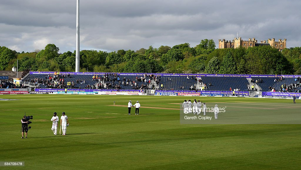 Chris Woakes and Moeen Ali of England leave the field at stumps on day one of the 2nd Investec Test match between England and Sri Lanka at Emirates Durham ICG on May 27, 2016 in Chester-le-Street, United Kingdom.