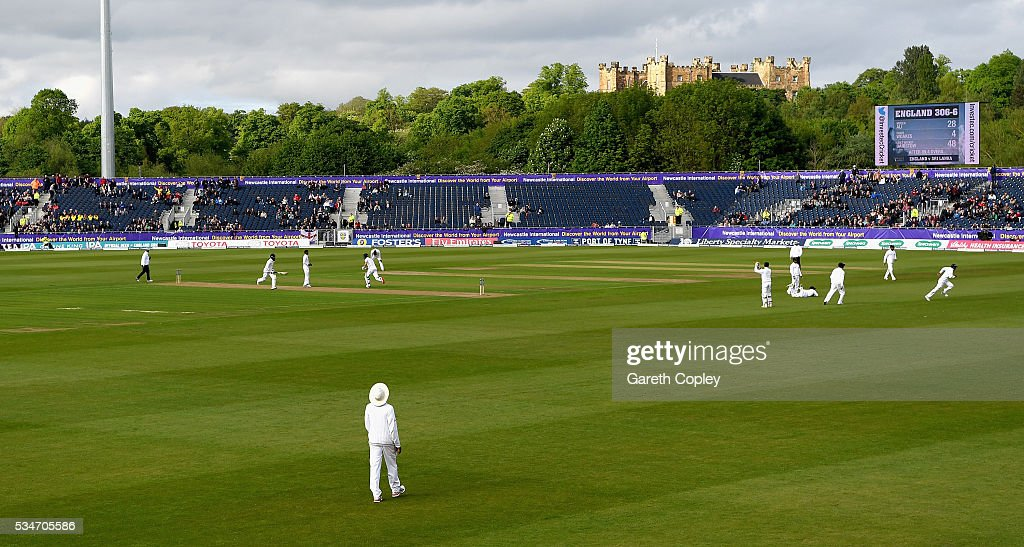 Chris Woakes and Moeen Ali of England score runs on day one of the 2nd Investec Test match between England and Sri Lanka at Emirates Durham ICG on May 27, 2016 in Chester-le-Street, United Kingdom.