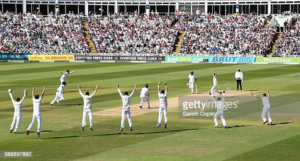Chris Woakes and the England slip fielders appeal for the wicket of Yasir Shah of Pakistan during day five of the 3rd Investec Test between England...