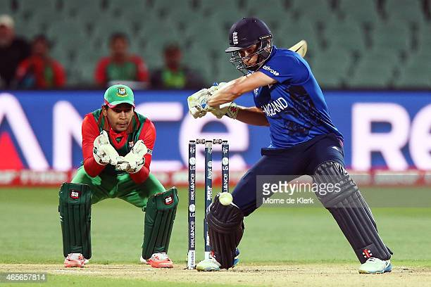 Chris Woakes of England bats in front of Mushfiqur Rahim of Bangladesh during the 2015 ICC Cricket World Cup match between England and Bangladesh at...
