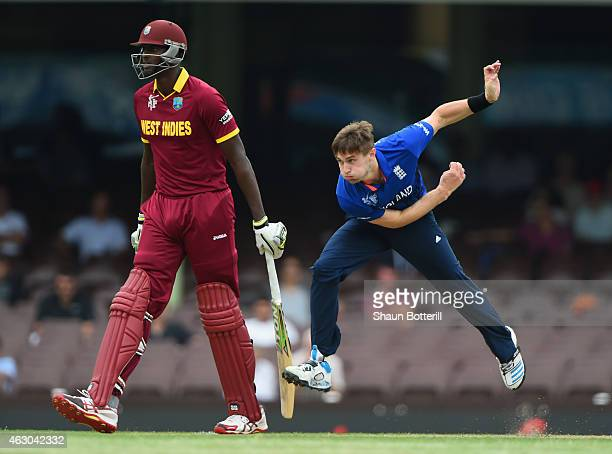 Chris Woakes of England bowls during the ICC Cricket World Cup warm up match between England and the West Indies at Sydney Cricket Ground on February...