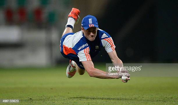 Chris Woakes of England catches during a nets session at Sheikh Zayed Stadium on November 7 2015 in Abu Dhabi United Arab Emirates