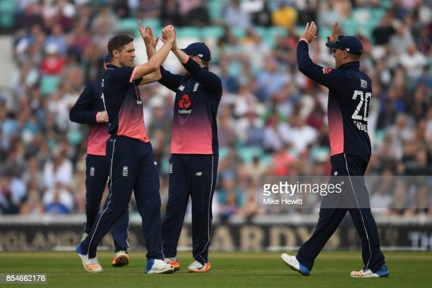 Chris Woakes of England celebates with team mates after dismissing Kyle Hope of West Indies during the 4th Royal London One Day International between...