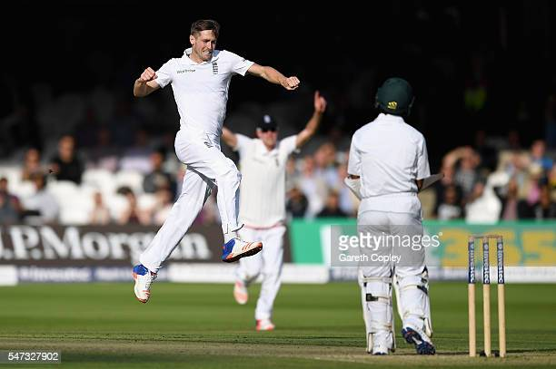 Chris Woakes of England celebrates dismissing Asad Shafiq of Pakistan during the 1st Investec Test between England and Pakistan at Lord's Cricket...