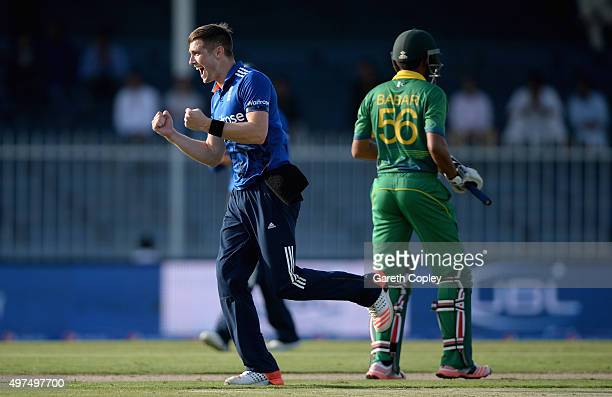 Chris Woakes of England celebrates dismissing Babar Azam of Pakistan during the 3rd One Day International match between Pakistan and England at...