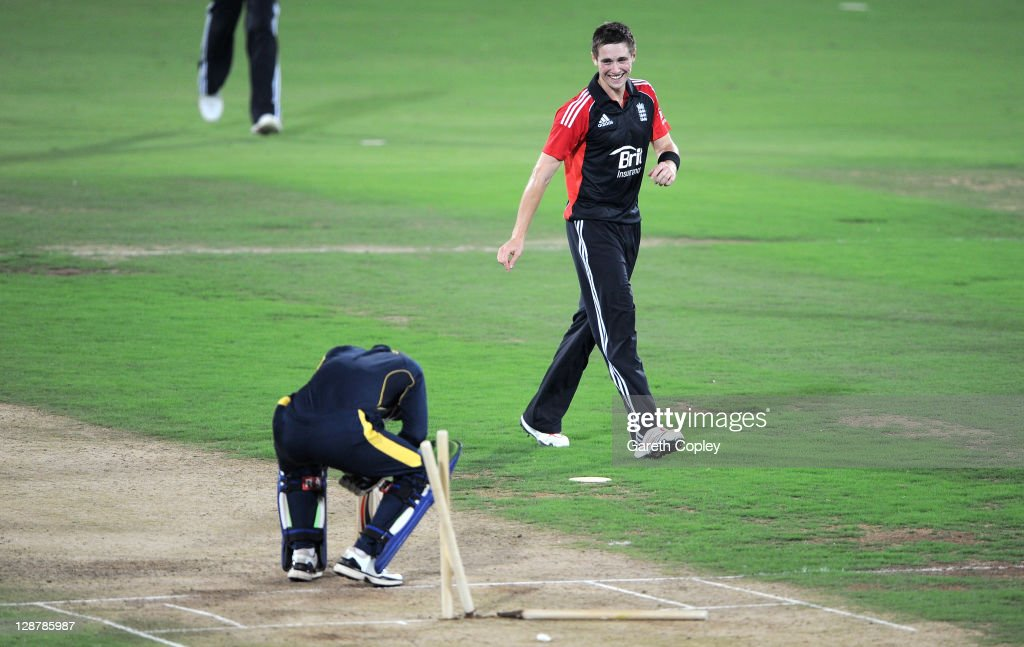 <a gi-track='captionPersonalityLinkClicked' href=/galleries/search?phrase=Chris+Woakes&family=editorial&specificpeople=4444585 ng-click='$event.stopPropagation()'>Chris Woakes</a> of England celebrates dismissing Ibrahim Khaleel of Hyderabad Cricket Association XI during the tour match between England and Hyderabad Cricket Association XI at The Rajiv Gandhi International Cricket Stadium on October 8, 2011 in Hyderabad, India.