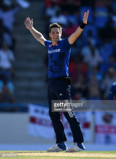 Chris Woakes of England celebrates dismissing Kraigg Brathwaite of the West Indies during the first One Day International between the West Indies and...