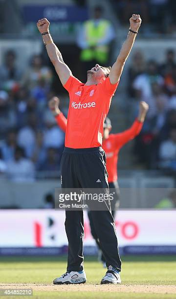 Chris Woakes of England celebrates dismissing Virat Kohli of India during the NatWest International T20 2014 match between England and India at...