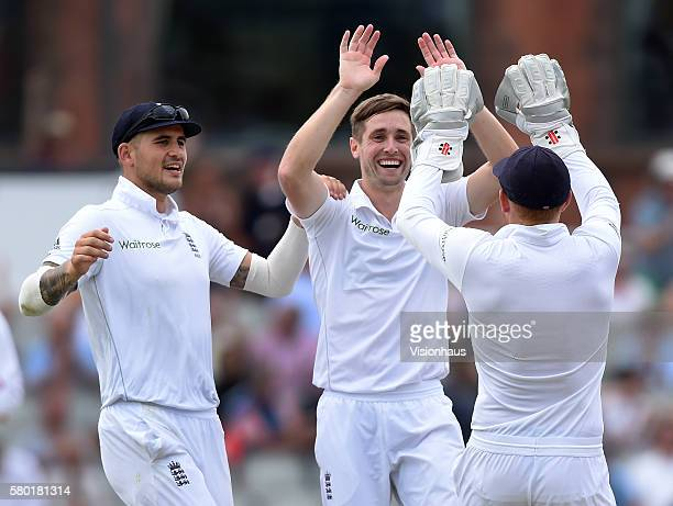 Chris Woakes of England celebrates taking the wicket of Azhar Ali during day two of the second test between England and Pakistan at Old Trafford on...