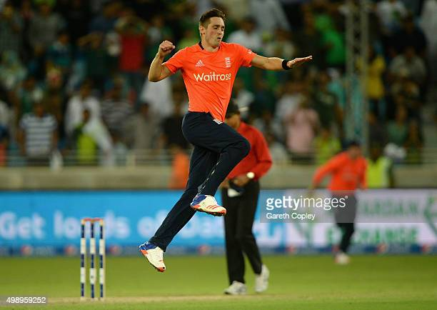 Chris Woakes of England celebrates winning the 2nd International T20 between Pakistan and England at Dubai Cricket Stadium on November 27 2015 in...