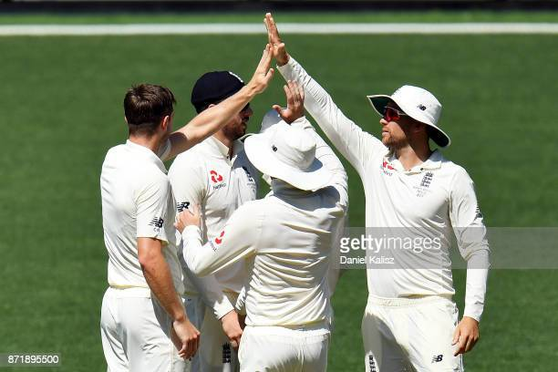 Chris Woakes of England celebrates with his team mates after dismissing Nick Larkin of CA XI during day two of the Four Day Tour match between the...