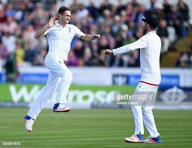 Chris Woakes of England celebrates with James Vince after dismissing Kusal Mendis of Sri Lanka during day two of the 2nd Investec Test match between...