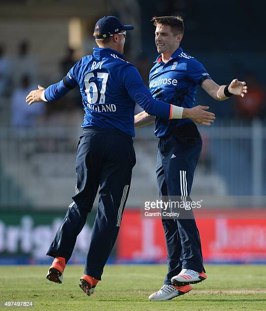 Chris Woakes of England celebrates with Jason Roy after dismissing Babar Azam of Pakistan during the 3rd One Day International match between Pakistan...
