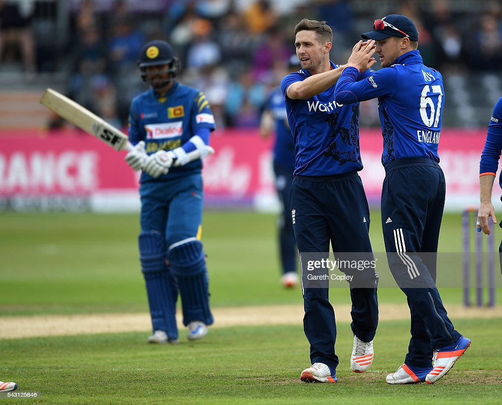<a gi-track='captionPersonalityLinkClicked' href=/galleries/search?phrase=Chris+Woakes&family=editorial&specificpeople=4444585 ng-click='$event.stopPropagation()'>Chris Woakes</a> of England celebrates with Jason Roy after dismissing Dinesh Chandimal of Sri Lanka during the 3rd ODI Royal London One Day International match between England and Sri Lanka at The County Ground on June 26, 2016 in Bristol, England.