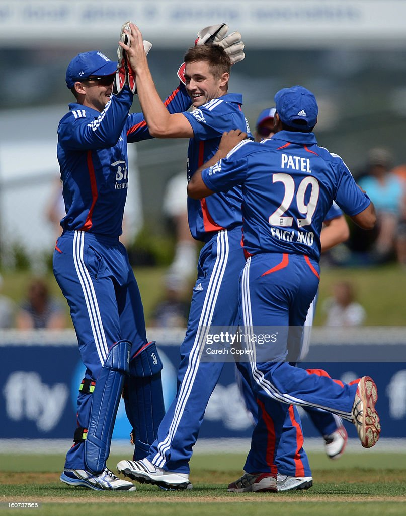 Chris Woakes of England celebrates with Jos Buttler and Samit Patel after dismissing Hamish Rutherford of a New Zealand XI during a T20 Practice Match between New Zealand XI and England at Cobham Oval on February 5, 2013 in Whangarei, New Zealand.