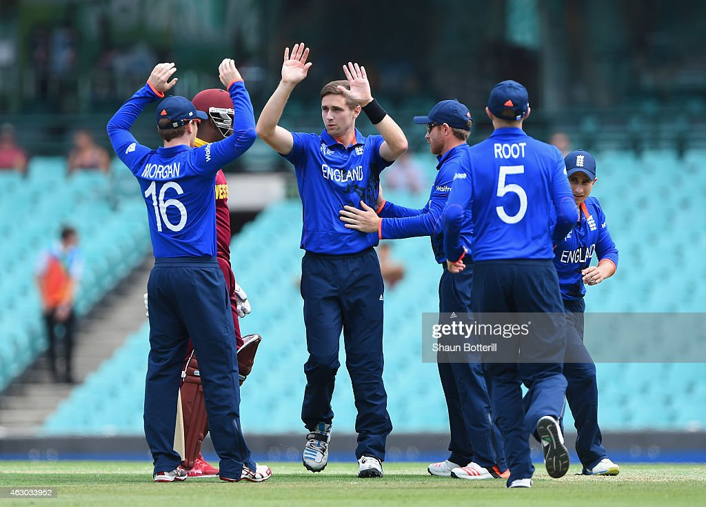 <a gi-track='captionPersonalityLinkClicked' href=/galleries/search?phrase=Chris+Woakes&family=editorial&specificpeople=4444585 ng-click='$event.stopPropagation()'>Chris Woakes</a> of England celebrates with team-mates after taking the wicket of <a gi-track='captionPersonalityLinkClicked' href=/galleries/search?phrase=Darren+Bravo&family=editorial&specificpeople=4884685 ng-click='$event.stopPropagation()'>Darren Bravo</a> of West Indies during the ICC Cricket World Cup warm up match between England and the West Indies at Sydney Cricket Ground on February 9, 2015 in Sydney, Australia.