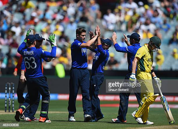 Chris Woakes of England celebrates with teammates after taking the wicket of Steve Smith of Australia during the 2015 ICC Cricket World Cup match...