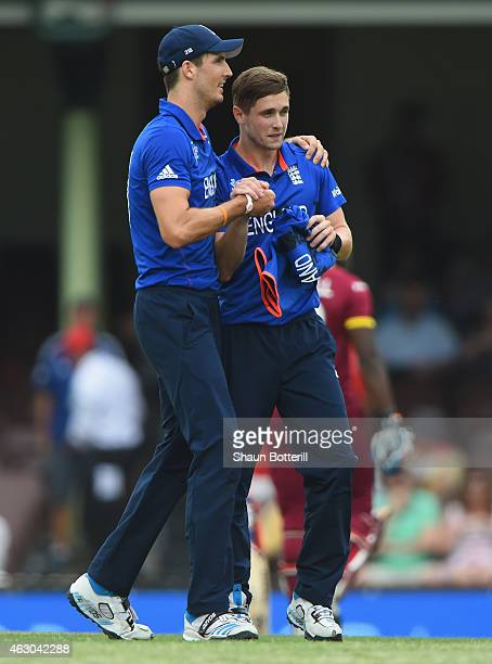 Chris Woakes of England is congratulated by teammate Steven Finn after taking the final wicket during the ICC Cricket World Cup warm up match between...