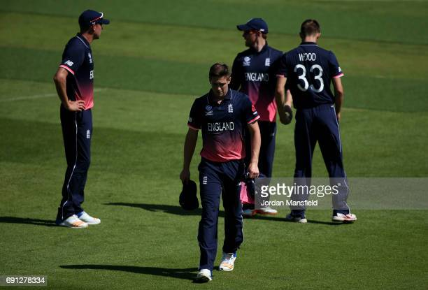 Chris Woakes of England leaves the field with an injury during the ICC Champions Trophy match between England and Bangladesh at The Kia Oval on June...