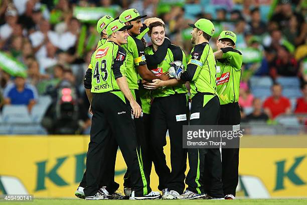 Chris Woakes of the Thunder celebrates with team mates after claiming the wicket of Callum Ferguson of the Strikers during the Big Bash League match...
