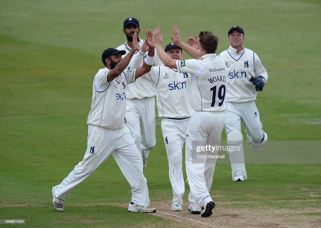 Chris Woakes of Warwickshire celebrates taking the wicket of Richard Levi of Northamptonshirel during the LV County Championship match between...