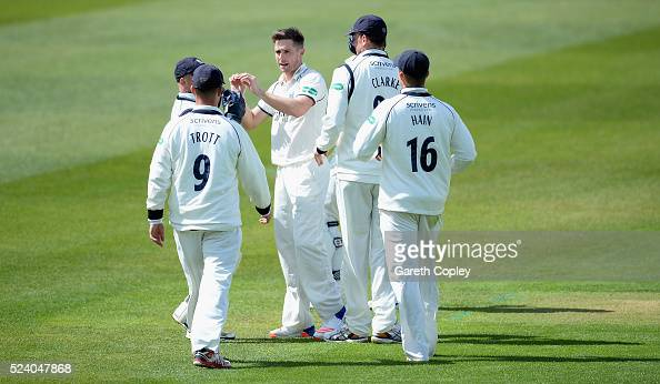 Chris Woakes of Warwickshire celebrates with teammates after dismissing Jack Leaning of Yorkshire during day two of the Specsavers County...