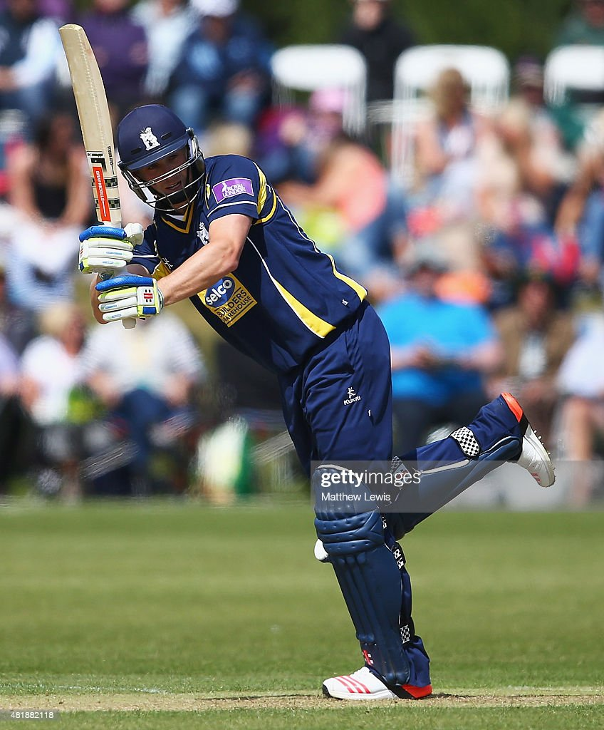 Chris Woakes of Warwickshire hits the ball towards the boundary during the Royal London OneDay Cup match between Nottinghamshire and Warwickshire at...