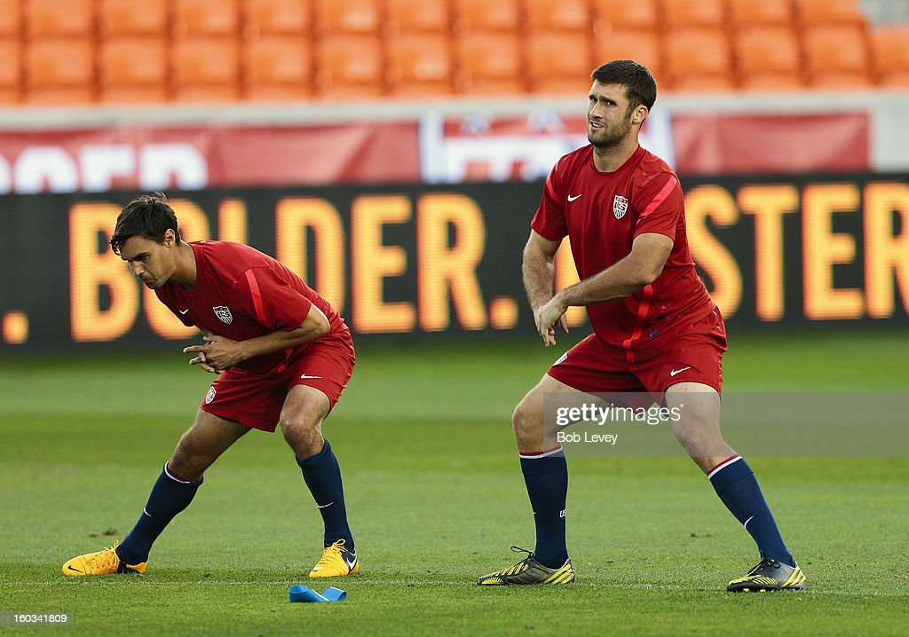 Chris Wondolowski, left, and Will Bruin stretch before a training session of the U.S. Men's National Team at BBVA Compass Stadium on January 28, 2013 in Houston, Texas.