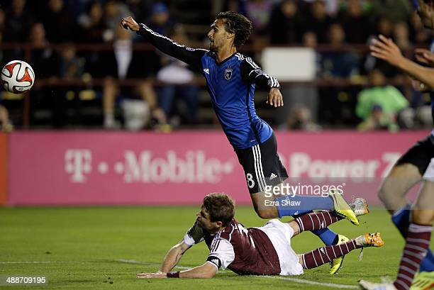 Chris Wondolowski of San Jose Earthquakes trips over Drew Moor of Colorado Rapids as he goes for the ball at Buck Shaw Stadium on May 7 2014 in Santa...