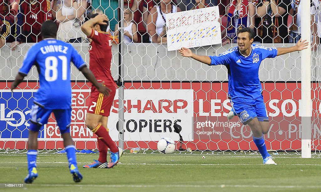 Chris Wondolowski #8 of the San Jose Earthquakes celebrates his game winning goal with his teammate Marvin Chavez #81 as Tony Beltran #2 of Real Salt Lake reacts during the second half of an MLS soccer game June 23, 2012 at Rio Tinto Stadium in Sandy, Utah. Beat Real Salt Lake 2-1.