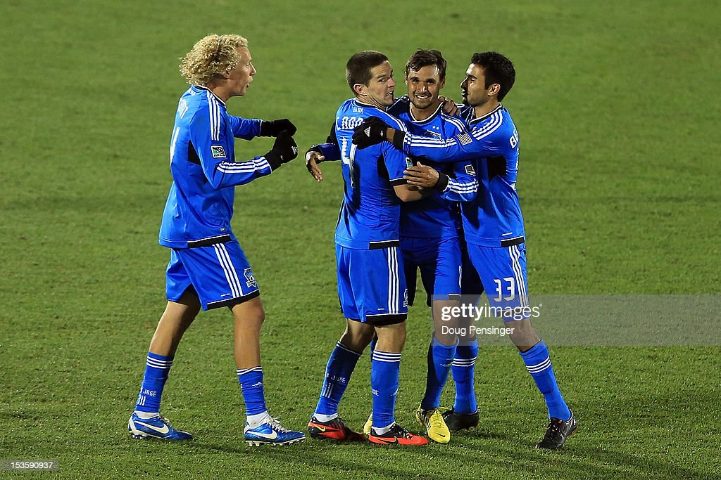 Chris Wondolowski of the San Jose Earthquakes celebrates his goal in the 83rd minute against the Colorado Rapids with Steven Lenhart Sam Cronin and...