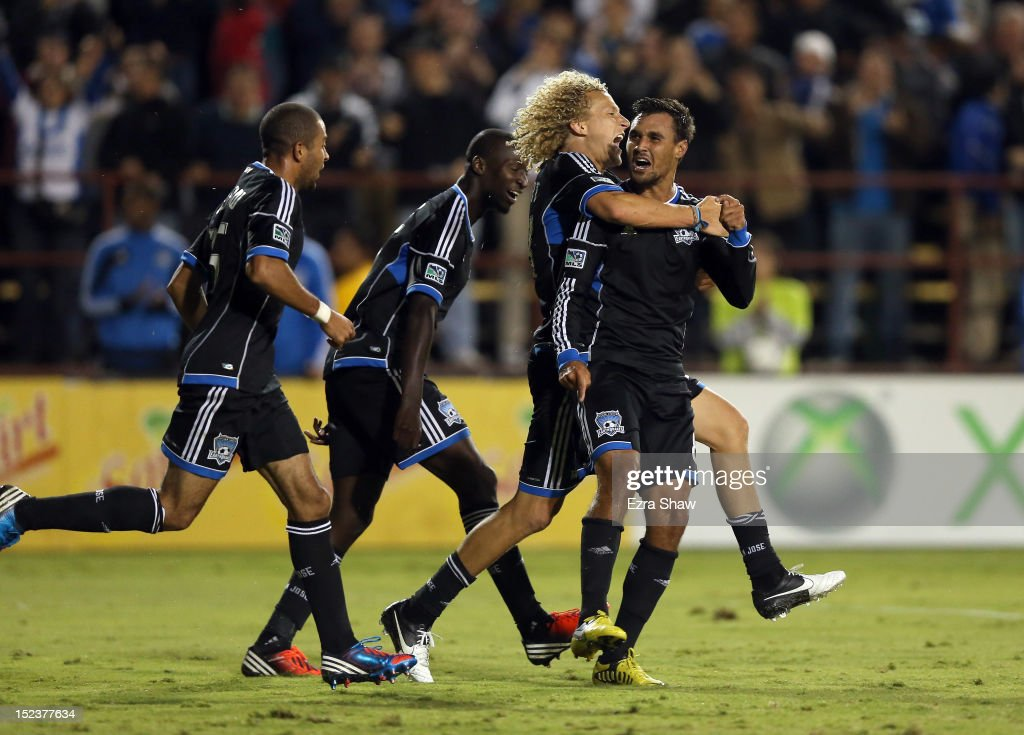 Chris Wondolowski of the San Jose Earthquakes celebrates with Steven Lenhart after he scored his second goal of their game against the Portland...