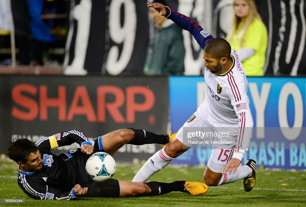<a gi-track='captionPersonalityLinkClicked' href=/galleries/search?phrase=Chris+Wondolowski&family=editorial&specificpeople=2579265 ng-click='$event.stopPropagation()'>Chris Wondolowski</a> #8 of the San Jose Earthquakes falls to the ground battling for control of the ball with <a gi-track='captionPersonalityLinkClicked' href=/galleries/search?phrase=Alvaro+Saborio&family=editorial&specificpeople=554699 ng-click='$event.stopPropagation()'>Alvaro Saborio</a> #15 of Real Salt Lake during their MLS Soccer game at Buck Shaw Stadium on March 3, 2013 in Santa Clara, California. Real Salt Lake won the game 2-0.