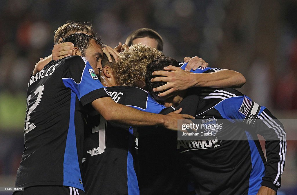 Chris Wondolowski of the San Jose Earthquakes is greeted by teammates including Ramiro Corrales Steven Lenhart and Anthony Ampaipitakwong as they...