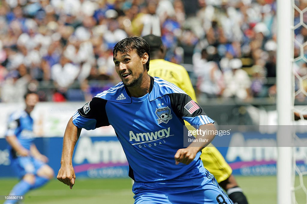 Chris Wondolowski #8 of the San Jose Earthquakes smiles after scoring against goalie Donovan Ricketts #1 of the Los Angeles Galaxy in the first half on August 21, 2010 at Buck Shaw Stadium in Santa Clara, California.