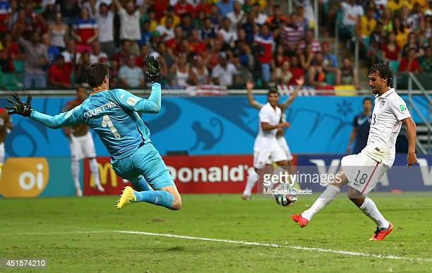 Chris Wondolowski of the United States misses a chance against Thibaut Courtois of Belgium during the 2014 FIFA World Cup Brazil Round of 16 match...