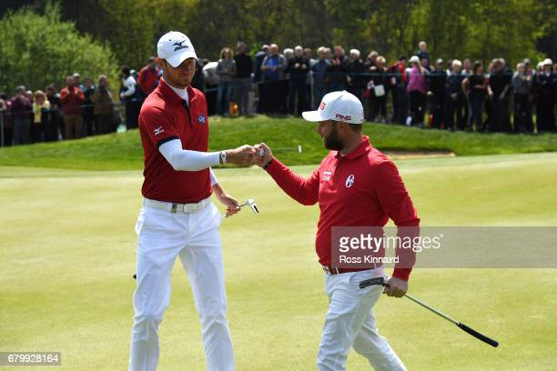 Chris Wood and Andy Sullivan of England celebrate a birdie on the 3rd green during the quarter final match between England and Italy during day two...