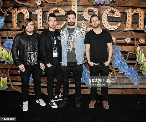 Chris Wood Dan Smith Kyle Simmons and Will Farquarson of Bastille attend the Nielsen PreGRAMMY celebration at HYDE Sunset Kitchen Cocktails on...