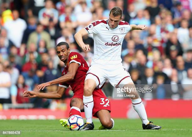 Chris Wood of Burnley and Joel Matip of Liverpool battle for possession during the Premier League match between Liverpool and Burnley at Anfield on...