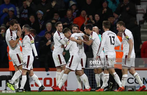 Chris Wood of Burnley celebrates after scoring his sides first goal with his Burnley team mates during the Premier League match between AFC...