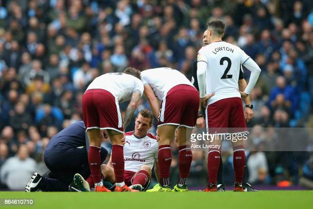 Chris Wood of Burnley is given treatment during the Premier League match between Manchester City and Burnley at Etihad Stadium on October 21 2017 in...