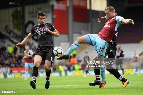 Chris Wood of Burnley shoots on goal under pressure from Luka Milivojevic of Crystal Palace during the Premier League match between Burnley and...
